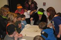 Children partcipate in the library's Worm race program