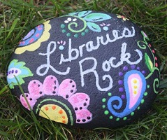 Rock painted to say Libraries Rock