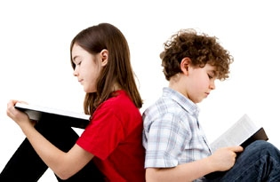 Two tweens sitting back to back reading books